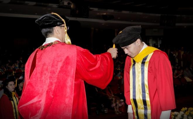 Matthew during his bachelor graduation ceremony, 2014.